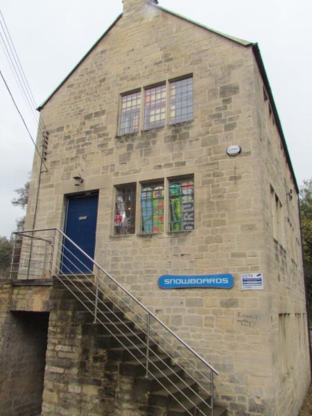 Another restored mill building where you can see brightly coloured surfboards through windows!