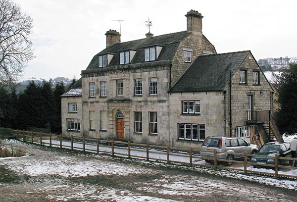 A double fronted Georgian house, built from Cotswold stone.