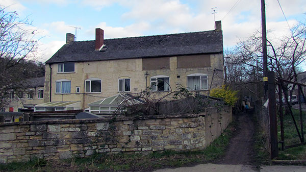 Several three storey stone cottages, in a row, can be seen from the pathway. There is no longer any canal at this point.