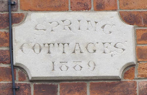 Stone plaque reading 'Spring Cottages 1889