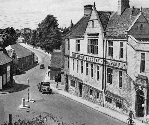 This black and white photograph shows the brewery and a very quiet road where the roundabout is today.